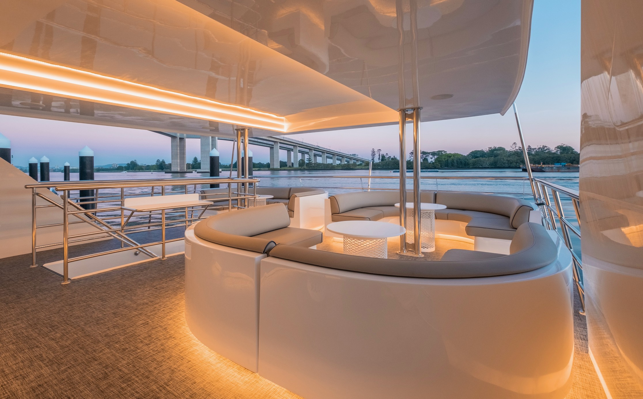luxury boat interior with lighting under the seats with view of the river
